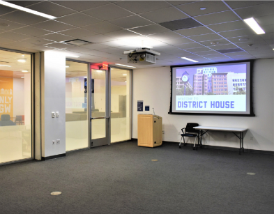 Empty meeting room with podium and projection screen at front of room
