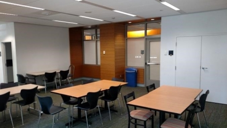 South Hall Community Room with 4 groups of working tables set up with chairs around