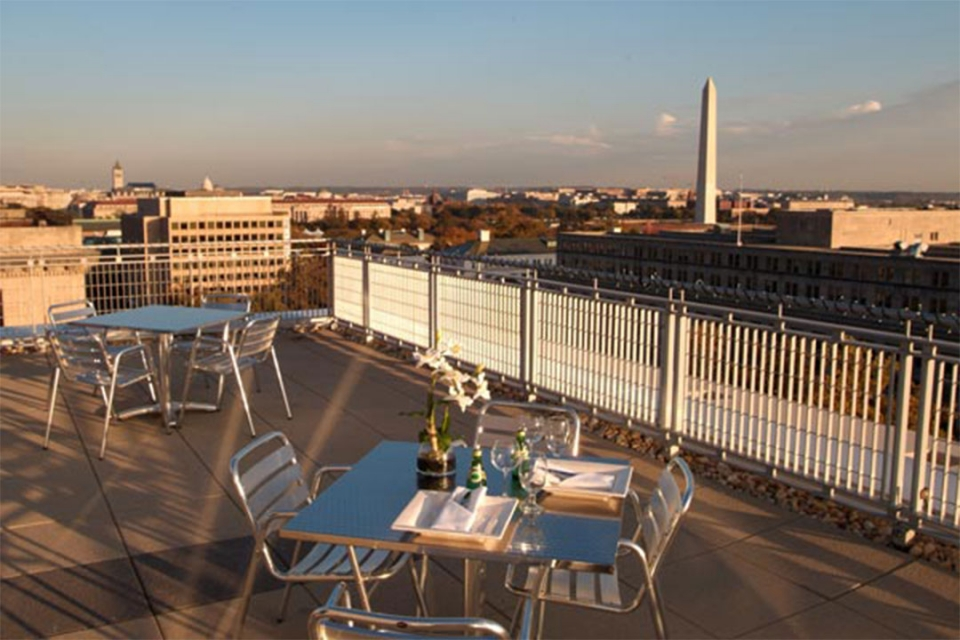 City View Room Terrace tables set for dinner with the National Mall in the background