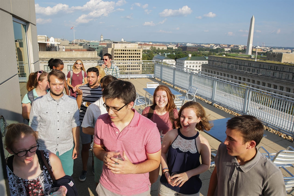 Students gathering on the City View Room Terrace