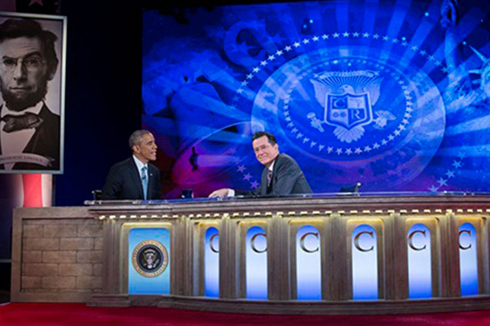 President Barak Obama on stage with Stephan Colbert