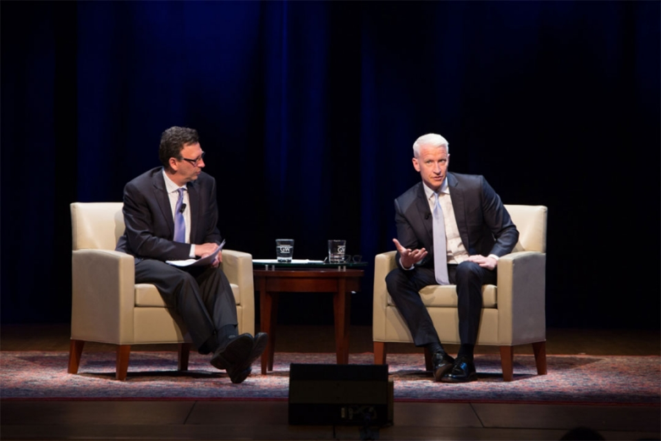 Anderson Cooper on stage with moderator