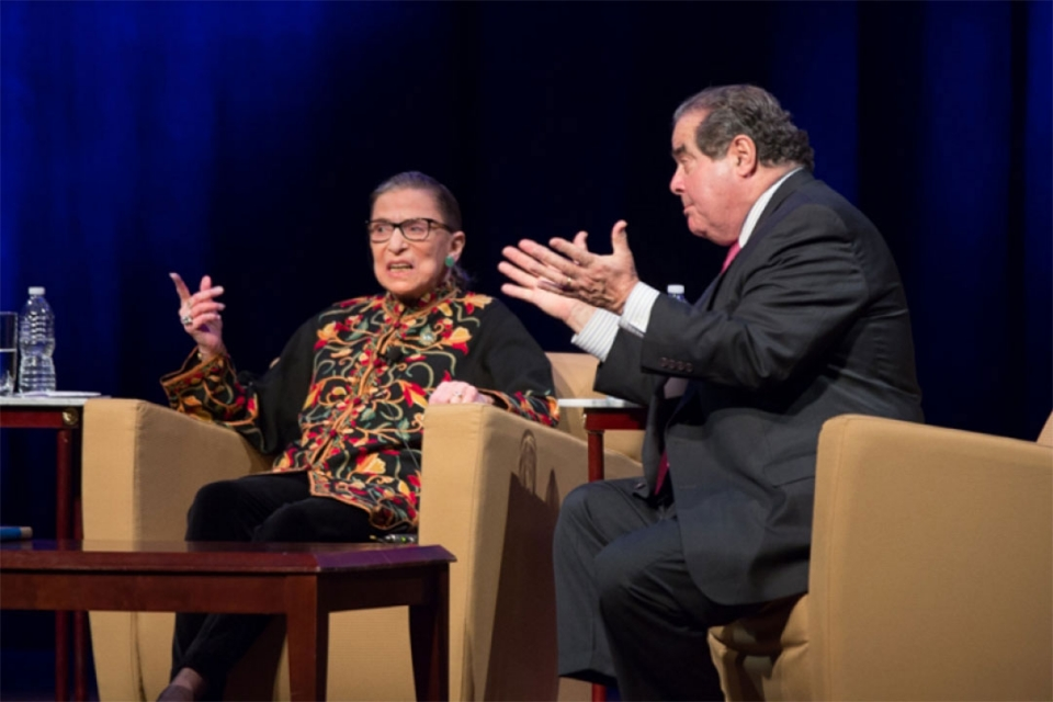 Ruth Bader Ginsburg onstage with a moderator