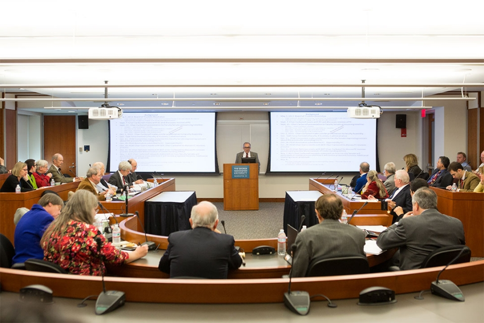 State Room event with audience and speaker showing a powerpoint presentation